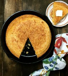 Old Fashioned Southern Cornbread in a cast iron pan with a slice cut out