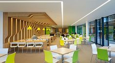 large cafe, seating, branding, linear recessed lighting, wayfinding, wood slat wall