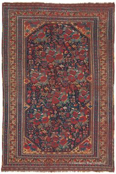 """QASHQAI, Southwest Persian 4ft 5in x 6ft 8in 3rd Quarter, 19th Century  From a collectible group of antique oriental tribal rugs that inventively recreate the European cabbage rose (known as the Guli Farang or """"Foreign Flower"""" motif) comes this lush, 150-year-old Qashqai rug with deeply saturated hues and lifelike drawing of its designs."""