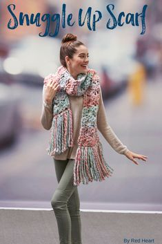 Snuggle Up Scarf crocheted in Collage. This yarn is the perfect combination of coziness and gorgeous colors. Get out a big hook and crochet this scarf in little time, then add fringe for the ideal finish!