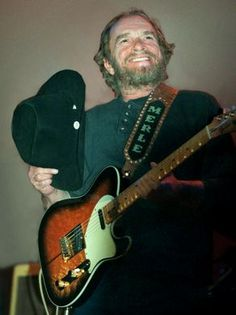 Merle Haggard takes his hat off to the crowd during his concert at the Ryman Auditorium on May 3, 2000.
