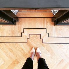 My hardwood herringbone floor, around my mantle is an artpiece. Love the Oak with Wenge wood double border.