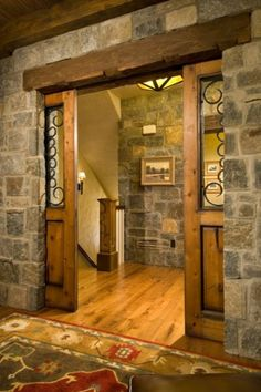 Pocket doors in stone facade wall.