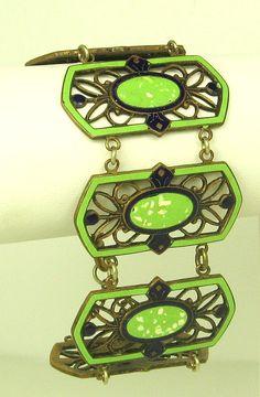 https://www.bkgjewelry.com/emerald-earrings/784-18k-yellow-gold-clip-on-diamond-emerald-snake-earrings.html Vintage Art Deco Bracelet
