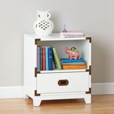 If you want a nightstand with a stylish design and an adventurous spirit, our Campaign Nightstand is the perfect candidate.  Its solid wood drawer provides plenty of storage and its brass finished drawer pulls and decorative corner brackets give it a refined touch.  Plus, it's available in multiple bold colors that'll stand out in any room.