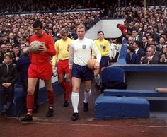 England captain Bobby Moore and his Wales counterpart Mike England lead their teams out in April 1967