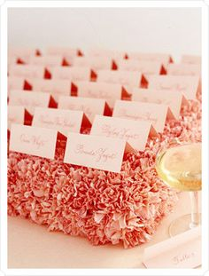 #Escort #cards on a bed of #pink #carnations