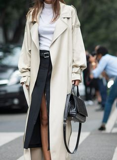 This long beige rain coat is effortlessly clean