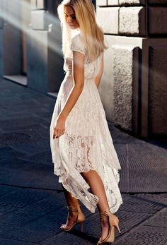Ethereal white lace - and she's NOT a bride! 15 Of The Most Glamorous Street Style Photos Ever via @WhoWhatWear