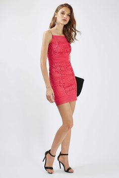 Opt for a classic look with this bodycon mini dress. We love the crochet trim detail and coral colour for a playful, boho vibe. Style it up with heeled sandals and a clutch for party ready chic.
