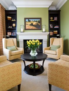 Love the bright green color and four chairs around the fireplace.