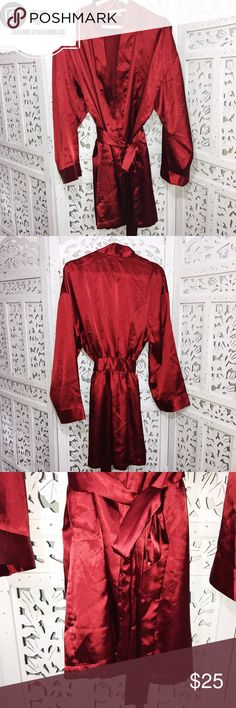 """🎀 VICTORIA' SECRET SATIN RED ROBE One size! Has a tie waist to give your waist a more defined look. Gorgeous red wine color. Great condition. It fits above the knee.     🎀""""Add to bundle"""" to add more items from my closet or """"Buy"""" to checkout now.  🎀Get to know me! 💗Showing you how to style your looks at www.Queenbeefashionblog.com SUBSCRIBE.   🎀 Let's be friends! Follow me on Instagram @queenbeefashionblog Victoria's Secret Intimates & Sleepwear Robes"""