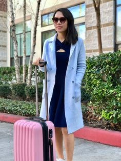 Carryon suitcase from Calpak Travel & prescription sunglasses from Eyebuydirect