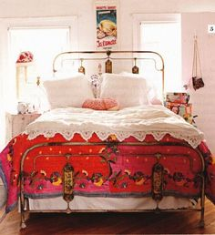 I love the use of white in different textiles, the old fashioned bedframe and the beautiful comforter...this is very much what I'm going for I think...I do wish my bedframed was lower so our legs wouldnt get trapped LOL