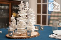 HGTV's @Liz Mester Gray used HGTV HOME Fabric squares cut with pinking shears to create this beautiful, winter tree centerpiece. This project is a great way to use up fabric scraps! #12DaysOfHGTVHOME