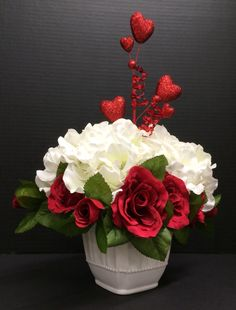 Valentine's 2015 Faux Floral: Red roses and a White Hydrangeas on a white ceramic beaded trim vase with Hearts holiday pick. Original design and arrangement by http://nfmdesign.synthasite.com/