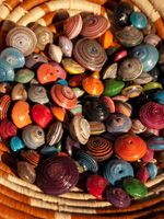 Addicted to this jewelry..   Beads are made by women in Uganda, out of recycled magazines and fabric.     Women helping women ♥
