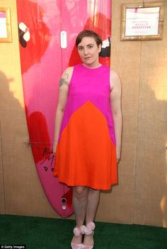 Pretty in pink: Lena Dunham also attended the event in a billowing orange and fuschia dress and silk pink stilettos which featured quirky pom-pom detailing