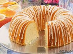 Million Dollar Pound Cake  1 pound butter, softened  3 cups sugar  6  eggs  4 cups all-purpose flour  3/4  cup milk  1 teaspoon almond extract  1 teaspoon vanilla extract     Orange Glaze -- Makes about 1/2 cup  11/2  cups confectioners' sugar  2 tablespoons orange juice