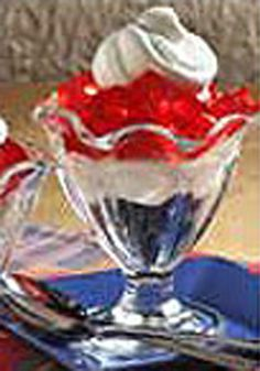 Red, White and Blueberry Parfaits -- This patriotic parfait recipe layers red gelatin cubes, whipped topping and blueberries in dessert dishes. Serve for the 4th of July!