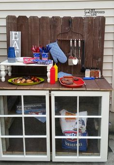 I love this diy outdoor buffet made from reclaimed wood and old windows.  I would probably use it as a potting bench.