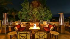 There are plenty of areas to enjoy the outdoors at night, like this outdoor area equipped with heat lamps and a fire pit.