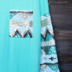 Soft oversize tunic with sequin pocket and sleeves in mint, ivory, or peach. Round bottom u-hem. Unlined. Color: sand, turquoise, ivory sand, turquoi