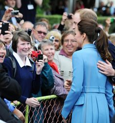 Smile for the camera! The Royal couple post happily for fans in New Zealand, during their recent tour. William lovingly rests his hand on Ka...