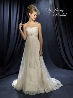 .this dress comes in Ivory over Champagne, Ivory over Irovy, or White on White!