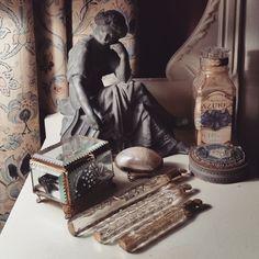 """Tear catchers"" on display alongside other Victorian-era ephemera."