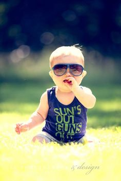 Sun's Out Guns Out ...hilarious! Normally, I despise tank tops on boys...but I could make an exception for this!!