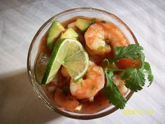 Mexican Shrimp Cocktail Recipe. Follow linked recipe or sub as follows:  1 large can V-8 juice (spicy if desired),  2 cucumbers seeded and chopped,  1 optional medium red onion chopped,  1/2 bunch cilantro chopped,  1 pound large shrimp peeled, de-veined, and steamed,  Limes quartered for decoration and flavor,  Tabasco sauce as desired.  Mix all ingredients in a large nonreactive container. Chill and serve.
