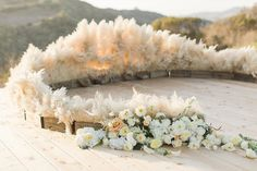The pampas grass in boxes creates a barrier while adding  visual interest.