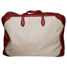 Clemence Leather Canvas Victoria 60 Travel Boston In Red Rouge and Natural | From a collection of rare vintage luggage and travel bags at https://www.1stdibs.com/fashion/handbags-purses-bags/luggage-travel-bags/