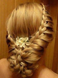 Waterfall braid, held together in the back w/ fresh flowers and clip.