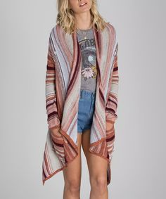 This billabong open cardi has pockets, a fun stripey knit, with colors I could stand to incorporate more of