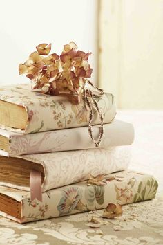 You could cover old books with wall paper or scrapbook paper & stack them as home decor.