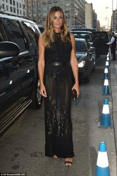 Sheer delight: Kelly Bensimon was naturally determined to show off the fruits of her hard-earned labour as she slipped into a racy sheer gown while attending the Zac Posen show at New York Fashion Week on Monday