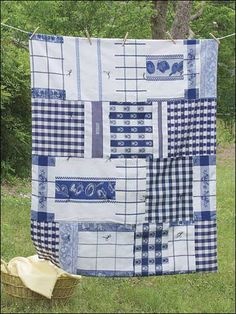 Dish Towel Throw- goes to show that all different kinds of things can be sewn together to make a quilt    (....cr....this is absolutely wonderful....i have seen dish towel throws before but not one done with all blue towels....I love blue, my favorite color and I love this one....I am going to look around)
