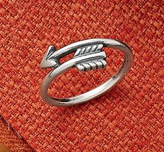 This dainty arrow ring can serve as a reminder that when it comes to dreams, we should always aim high. Wear it as a statement or stack it with other rings to create a look that's uniquely yours. Cute Jewelry, Jewelry Box, Jewelery, Avery Jewelry, James Avery Rings, Body Jewelry Shop, Arrow Ring, Watch Necklace, Women's Accessories