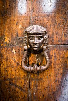 Antique Egyptian female figure knocker, close up view.