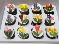 - Spring is in the air.     Fondant flower toppers --- Tulip, Cala lily, Daisy, Hyacinth, Daffodils and Blossoms.    Made these cupcakes for Teacher's Appreciation Day at my daughter's school.  Chocolate cupcakes with chocolate butter cream frosting.