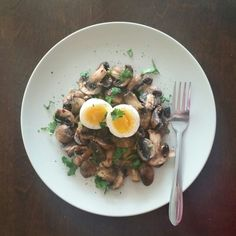 Soft eggs over garlic sautéed mushrooms.