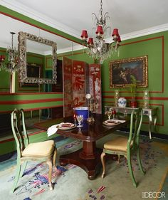 Brazilian architect João Mansur's São Paulo apartment is decorated in bold green-and-red — but there's nothing Christmas here! The English dining table was bought in Rio de Janeiro in the late 1980s, and the 19th-century chairs were found at a Paris flea market.   - ELLEDecor.com KĖDĖS