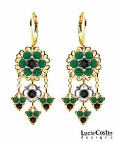24K Yellow Gold Plated over .925 Sterling Silver Chandelier Earrings by Lucia Costin with Flower Ornaments and Cute Charms, Accented with Black and Green Swarovski Crystals Surrounded by Filigree Details Lucia Costin. $78.00. Update your everyday style with inspiration when wearing this piece of jewelry. Adorned with black and emerald - green Swarovski crystals. Unique jewelry handmade in USA. A perfect feminine touch. Floral Earrings by Lucia Costin