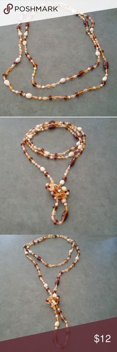 """Single Strand Glass Beads 60"""" long Beautiful glass beads strand that can be worn many different ways. 60"""" long. Colors are brown, yellow, gold, tan, and soft pink which makes this perfect to wear with that new millennial pink dress or top! Jewelry Necklaces"""