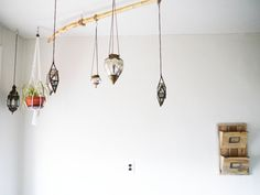 Inspired by a restaurant, Brandi was able to replicate the same fixture in her own home with branches that a friend was discarding, and lanterns from World Market.