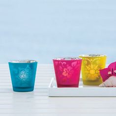 ADORABLE! Vibrant frosted glass cups shimmer with a metallic glow when lit with a tealight, sold separately. Trio includes one of each color/design. 2...