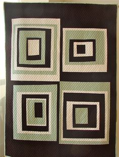 Love this modern quilt.  Easy to piece and the quilting is parallel lines, one inch apart. Make this! It's sort of a wonky log cabin design.