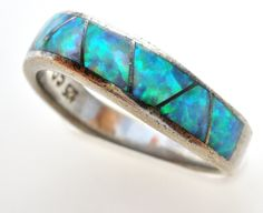 """Gemstone Jewellery Rings - This is a sterling silver band with inlay opal gemstones. It is hallmarked 925, signed CO, is a size 6, measures slightly under.25"""" wide, and weighs 2.7 grams. Great conditi"""